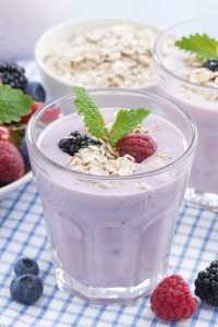 healthy berry smoothies with oatmeal in a glass, close-up, verti