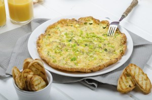 Omelette with zucchini and mozzarella cheese, scallions
